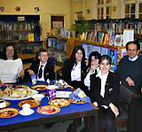 Latin pupils with a Roman meal.
